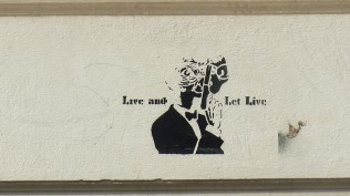 "Stencil; Unknown Artist; ""Live and let live""; ""ET-Bond"""